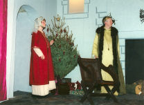 King Henry and Queen Eleanor prepare for the Christmas Court at Chinon.
